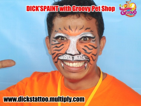 face painting with groovy harimau 2