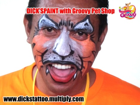 face painting with groovy harimau